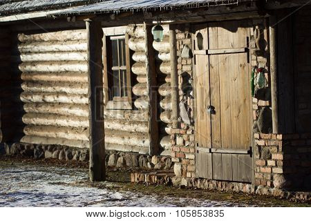 Entrance To The Wooden House Built Of Logs.