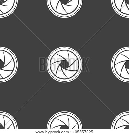 Diaphragm Icon. Aperture Sign. Seamless Pattern On A Gray Background.