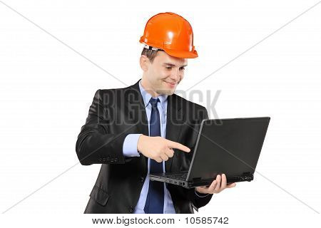 An Architect Pointing At Laptop