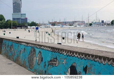 GDYNIA POLAND - JULY 27 2015: Fish drawings on a wall by a beach in the evening