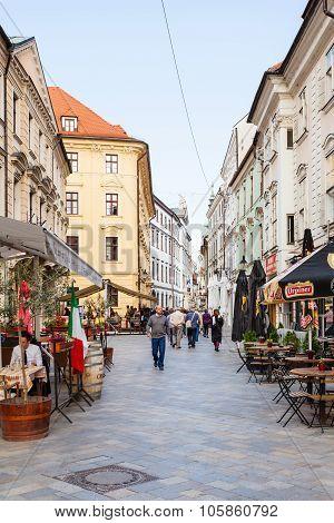 Tourists Walk On Venturska Street In Bratislava