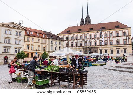 People Buy Vegetables At Cabbage Market In Brno