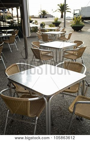 Metal Rattan Tables And Chairs Outdoor Of Restaurant.