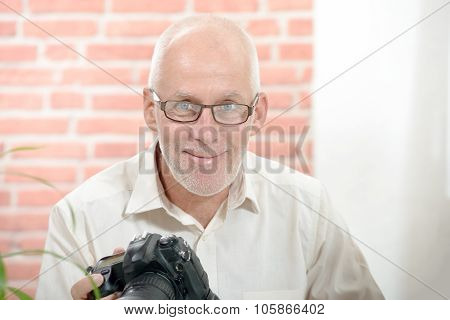portrait of a middle-age smiling photographer