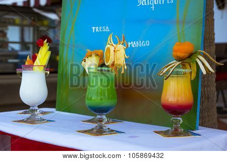 Delicious Layered Alcoholic Cocktails In Glasses, Decorated With Exotic Fruits, Tenerife