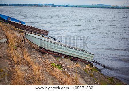 Romantic Small Boat On Shore