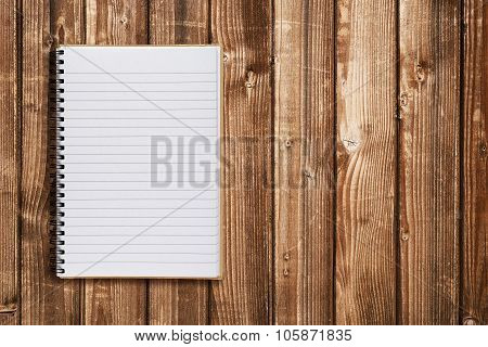 Notepad On Wooden Table