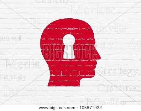 Advertising concept: Head With Keyhole on wall background