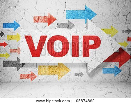 Web development concept: arrow with VOIP on grunge wall background