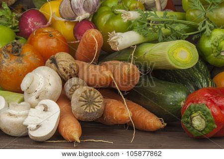 Various types of vegetables on an old wooden table. The concept of diet food.