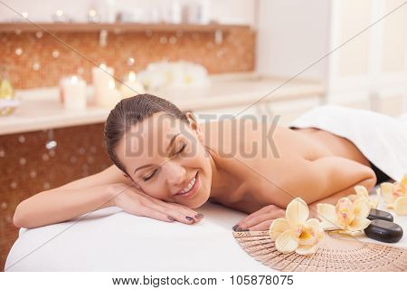 Cheerful healthy lady is resting beauty salon