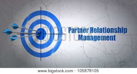 Finance concept: target and Partner Relationship Management on wall background