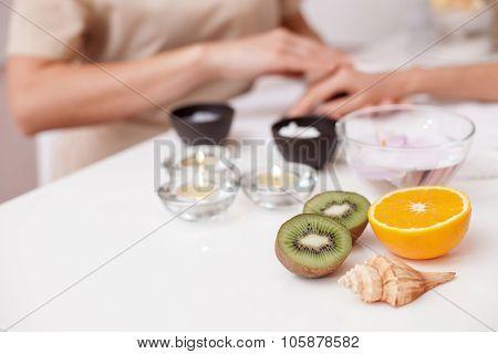 Skillful beautician making moisturizing procedure at beauty salon
