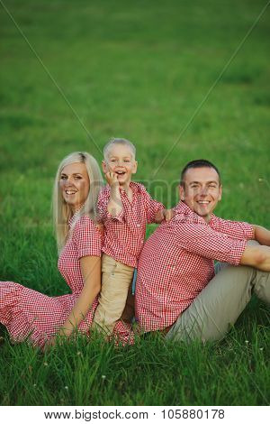 happy family on green grass