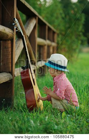 cute little cowboy playing guitar