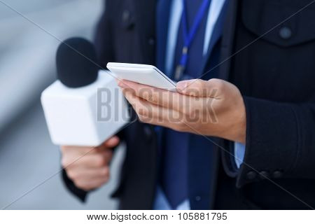 Close up of mans hand holding the smartphone.