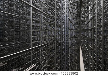 Industrial construction of many metal grey girders on modern plant