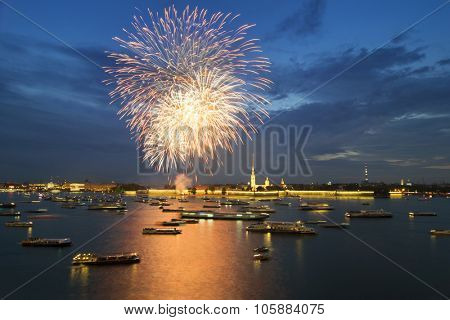Many ships and boats on Neva river and fireworks at night in St. Petersburg, Russia