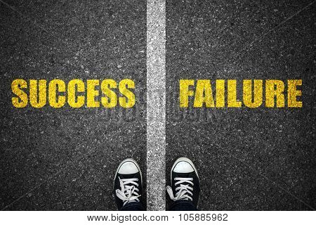 Success And Failure Road Line On Asphalt