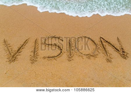 Vision Inscription Written On Sandy Beach With Wave Approaching