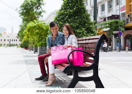 Asian couple after shop sitting bench shopping  bag