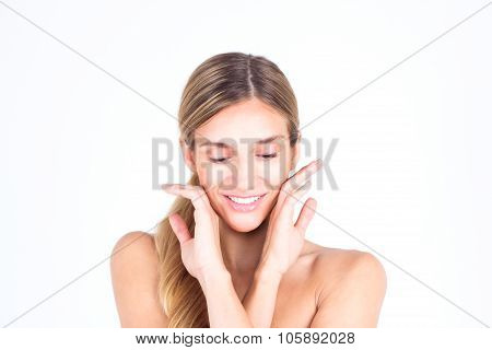 Spa & Beauty. Beautiful and clean face of woman. Beautiful woman touching her face with both hands a