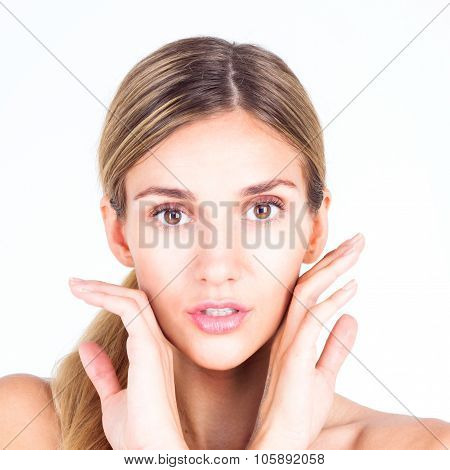 Spa & Beauty. Beautiful and clean face of woman. Beautiful woman touching her face with both hands