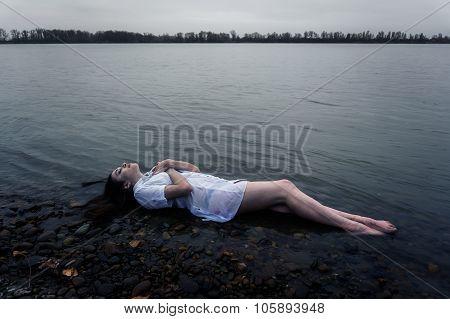Floating Girl In Dark River