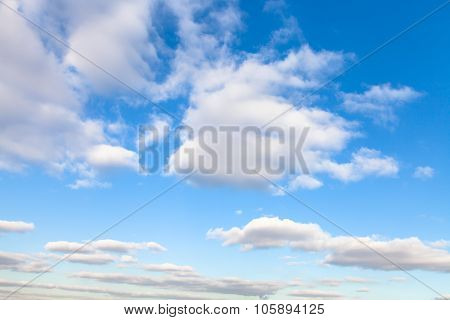 Stratus Clouds In Blue Sky In Autumn Sunny Day