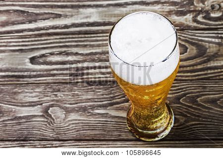 Glass Of Fresh Lager Beer On A Wooden Table.