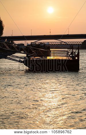 Jetty On Danube River At Yellow Dawn