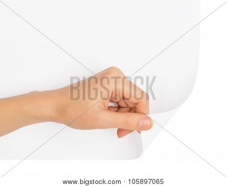 Humans hand turning blank page corner