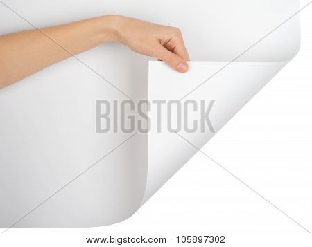 Womans hand turning empty page corner