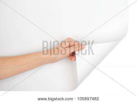 Hand turning bottom empty page corner