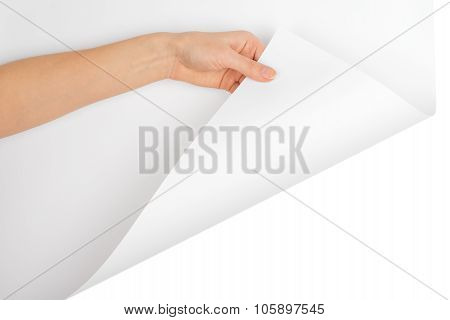 Womans hand turning bottom empty page corner