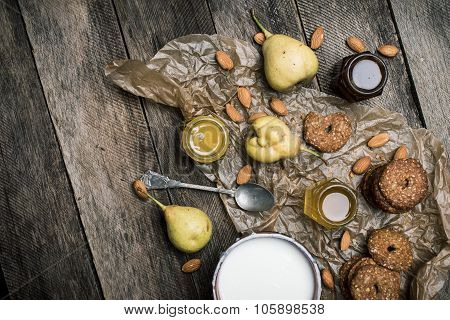 Pears Nuts Cookies And Joghurt On Rustic Wood