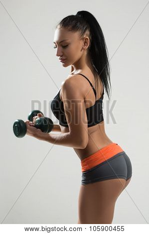 Sexy athletic woman with long hair. back