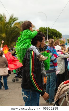 Santa Cruz, Spain - February 12: Dressed-up Child On Father's Shoulders Awaiting  The Parade For One