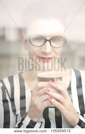 Woman Behind Window Holding A Glass Of Coffee