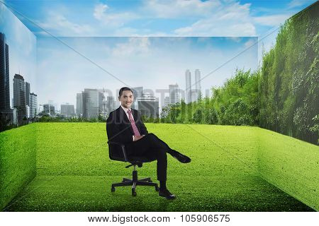 Asian Business Person Sitting On The Chair On The Room