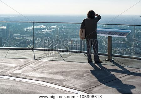 Visitor standing on the Main Tower observation deck