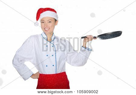 Beautiful Smiling Asian Chef With Frying Pan And Christmas Hat