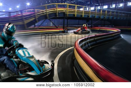 Two cart racers are racing on the grand track