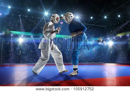 Two kudo fighters are fighting on the grand arena