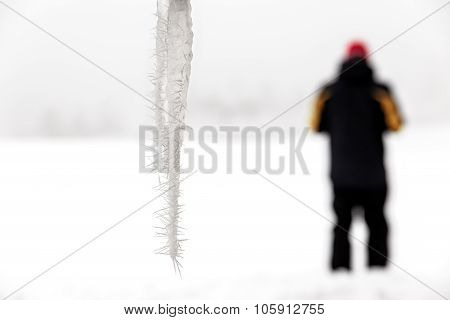 Icicles With A Standing Person In The Background