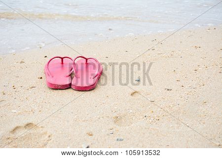 Red Old Slippers And Flower On The Beach Background
