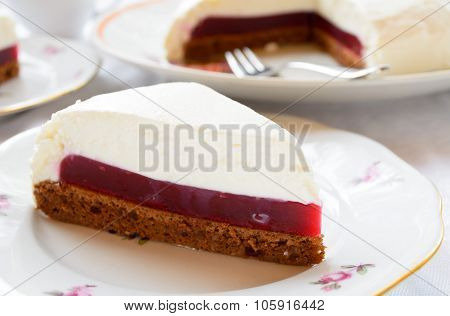 Souffle cake with berry jelly and chocolate biscuit
