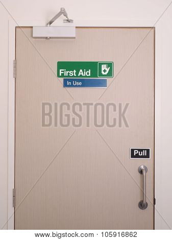 First aid door and sign with occupied indicator