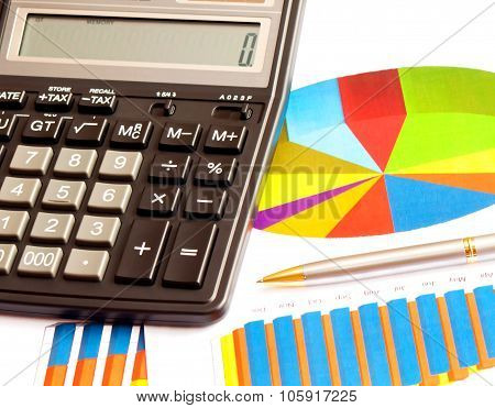 Business Picture: Calculator And Financial Graphs