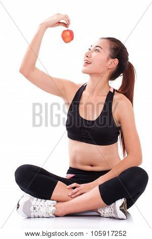 Fitness young woman holding apple on white background. healty concept